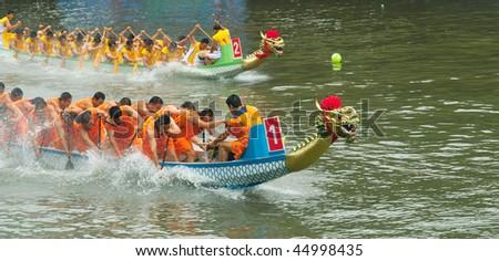 FOSHAN CITY, CHINA - MAY 30: Participants in action at Fenjiang River Dragon Boat Race May 30, 2009 in Foshan City, China