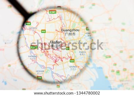 Foshan, Foshan city visualization illustrative concept on display screen through magnifying glass #1344780002