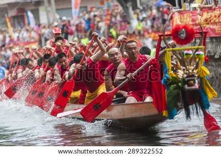 FOSHAN-June 21:The Dragon Boat Festival dragon boat in Fen rivers, there are 17 dragon boat teams took part in the game, attracted tens of thousands of people watched June 21, 2015 in Foshan, China