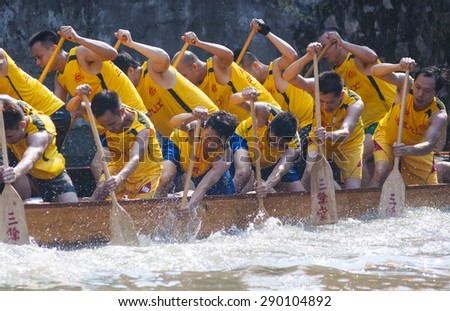 FOSHAN-June 20:The Dragon Boat Festival dragon boat in Fen rivers, there are 17 dragon boat teams took part in the game, attracted tens of thousands of people watched June 20, 2015 in Foshan, China