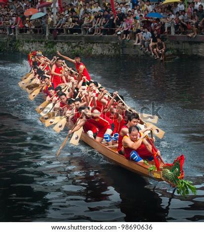 FOSHAN, MARCH 23: Dragon Boat Race Held In Foshan River, The Annual Dragonboat Festival, Foshan Villages To Host The Dragon Boat Race March 23, 2012 in Foshan, China
