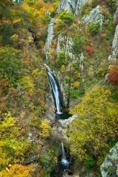 Fotinovo waterfalls (Fotinski waterfall) in Rhodopes Mountain, Pazardzhik region, Bulgaria. Amazing autumn landscape