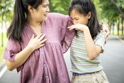 Foul-smelling woman was hug her daughter while her child girl closing nose and can smell the armpit smelly or the body odor foul from her mother,feel stinks,asian female smell ,sweat from hot weather