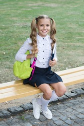 Foundation for future. Happy child back to school. Small kid sit on bench. Childhood development. Child and childhood. Study and education. Childhood and school days. Give every child happy childhood.