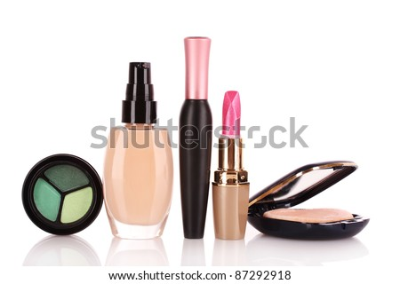foundation, mascara, face powder and lipstick isolated on white
