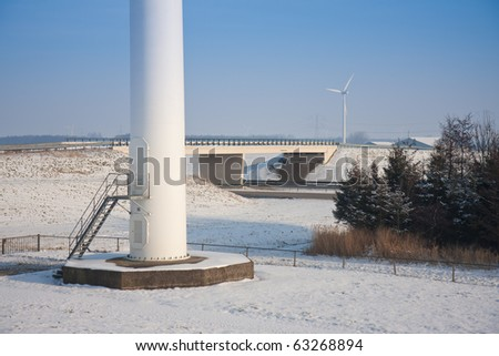 Foundation of a big windmill near a motorway in a snowy landscape of the Netherlands