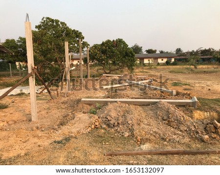 Foundation pillars of buildings constructed of steel and cement on the construction site