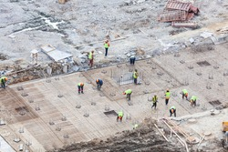 Foundation with working people