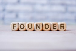 Founder word written on wood block