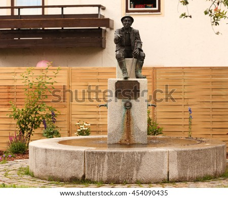 http://image.shutterstock.com/display_pic_with_logo/748867/454090435/stock-photo-fountain-and-monument-at-the-birthplace-of-hausham-wastl-witt-454090435.jpg