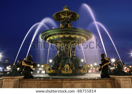 Fountain at Place de la Concord by dusk - stock photo
