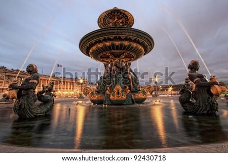 Fountain at Place de la Concord in Paris France  by dusk