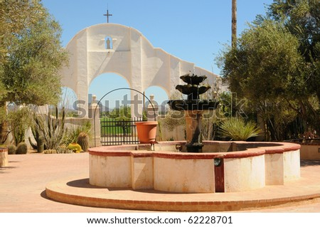 Fountain at Spanish mission San Xavier del Bac started in 1692 by Spanish missionaries in the Americas - stock photo