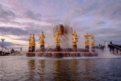 Fountain Friendship of peoples at sunset. One of the main symbols of the Soviet era. Sixteen female statues of the fountain represent the 16 Soviet republics. Moscow. Russia.