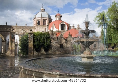 Fountain in front of a church in Morelia, Mexico - stock photo