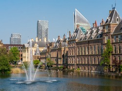 Fountain in front of the Dutch parliament. With the skyline of The Hague in the background.  Built in the 13th century, the Binnenhof is the oldest House of Parliament in the world still in use.
