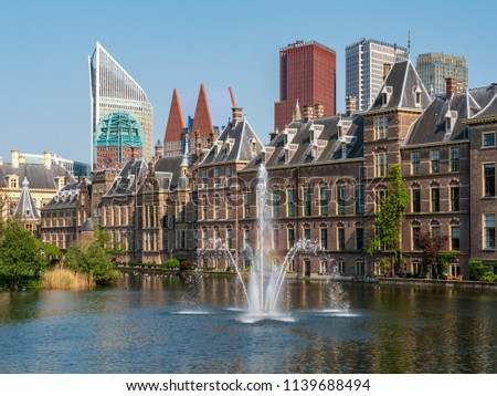 Photo of  Fountain in front of the Dutch parliament. With the skyline of The Hague in the background.  Built in the 13th century, the Binnenhof is the oldest House of Parliament in the world still in use.
