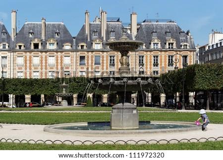 fountain in place des Vosges,Paris