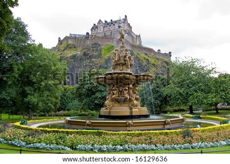 fountain in princes street gardens with edinburgh castle in the background