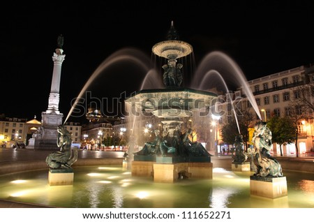 Fountain in Rossio square Lisbon at night time  Portugal