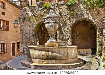 Fountain in St Paul de Vence in France, built 1615 by Martin Melchior. #1229529922