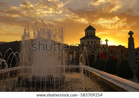 Fountain in the Holy Trinity Cathedral at sunset, Tbilisi, Georgia #583709254