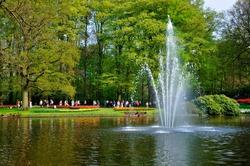 Fountain in the river in Keukenhof park in Holland