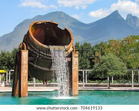 Fountain made of parts of a metal melting furnace