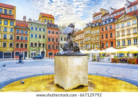Fountain Mermaid and colorful houses on Old Town Market square in Warsaw, capital of Poland #667129792