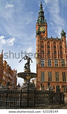 Fountain of the Neptune and city hall in Gdansk - Poland