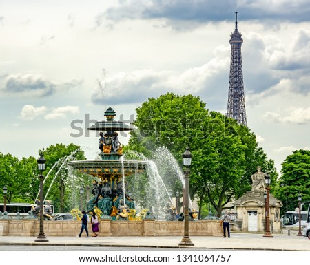 Fountain of the Seas (Fontaine des Mers) on place de la Concorde square and Eiffel tower at background, Paris, France #1341064757