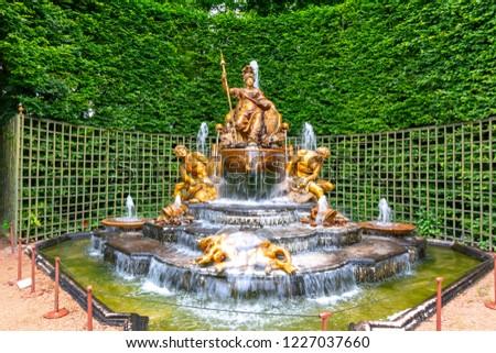Fountain of Triumphant France (Le Bosquet de l'Arc de Triomphe) in Versailles gardens, Paris, France