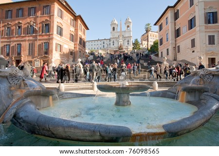 fountain on Spanish square with Spanish Steps on background, Rome