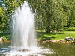 Fountain on the lake in the landscape park Mezhigirya near Kiev, Ukraine.