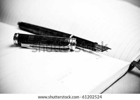 Fountain pen and calendar in composition in black and white