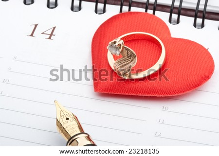 Fountain pen,  calendar page and ring. Valentines day card.