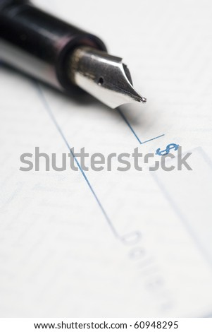 fountain pen on a blank check - stock photo