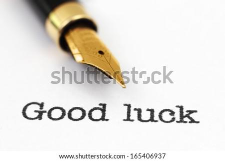 Fountain pen on good luck text
