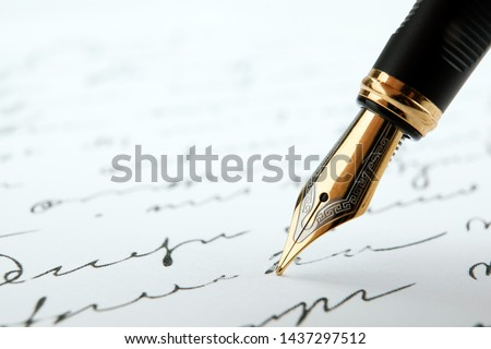 fountain pen on paper with ink text on a white background closeup Stock photo ©