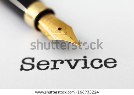 Fountain pen on service text