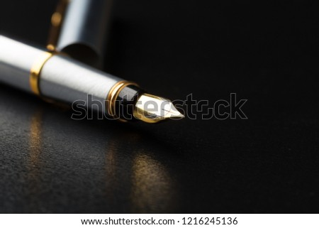 Fountain pen with clipping path on black background