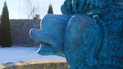 Fountain statue of Neptune in winter. Stock footage. Beautiful sculpture of Neptune sitting on dolphin stands in inactive fountain in winter
