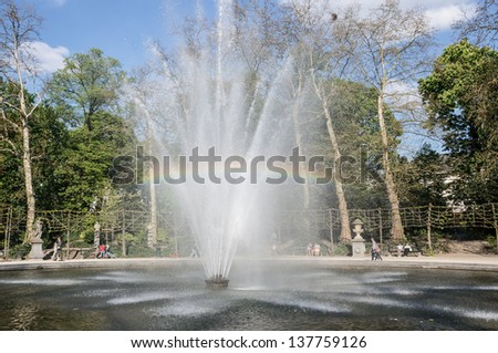 Fountain with rainbow in the park of brussels, Belgium