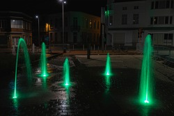 Fountains on market of izegem at night.  Detailed picture with green water in a good shot