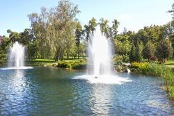 Fountains on the lake in the landscape park Mezhigirya near Kiev, Ukraine.