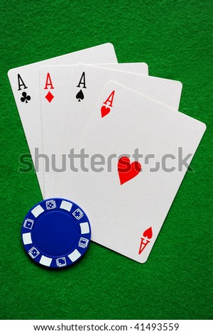 Four Aces and a blue poker chip