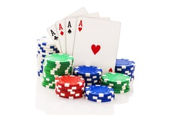 Four aces and stacks of poker chips isolated on white.