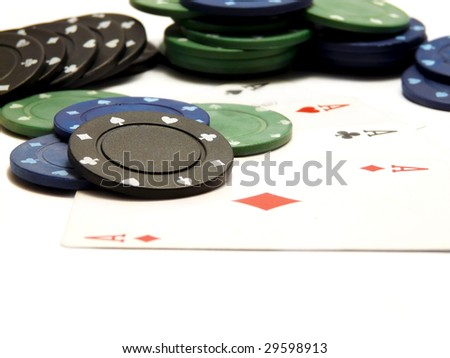 Four aces cards and casino chips