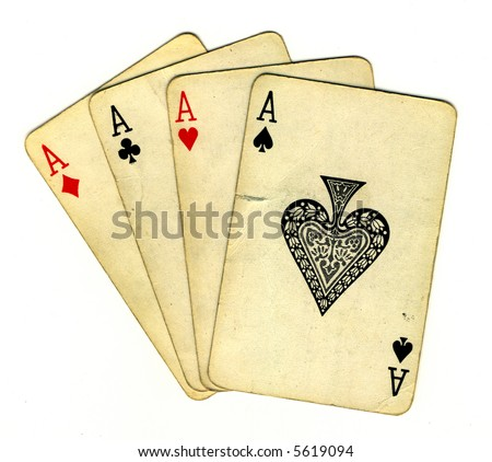 Four aces (isolated from the background with a clipping path), old used cards