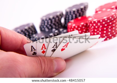 four aces with poker chips on white background